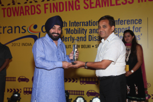 Picture of Dr. D.N. Dimri, Superintending Archaeologist, Delhi Circle of ASI, receiving the Award on behalf of ASI