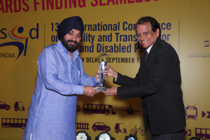 Picture of Mr. R. Hari receiving the award on behalf of The Lemon Tree Hotel Company at the hands of Sh. Aravinder Singh Lovely, the Hon'ble Minister for Urban Development, Govt. of Delhi